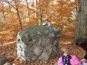 One kid on a rock