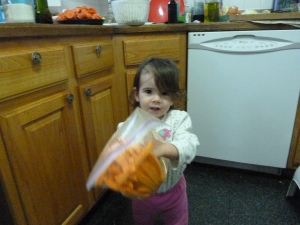 Little helper shaking the sweet potato bag!