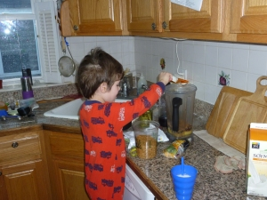 Adding flaxseeds to his smoothie