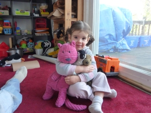 Adorable kid with stuffed animals