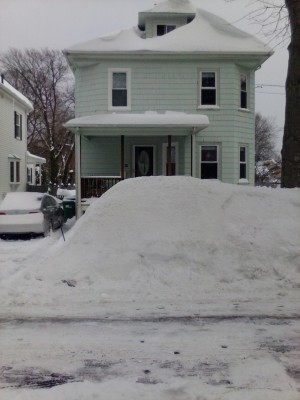 Our house, peeking out from behind the snow pile